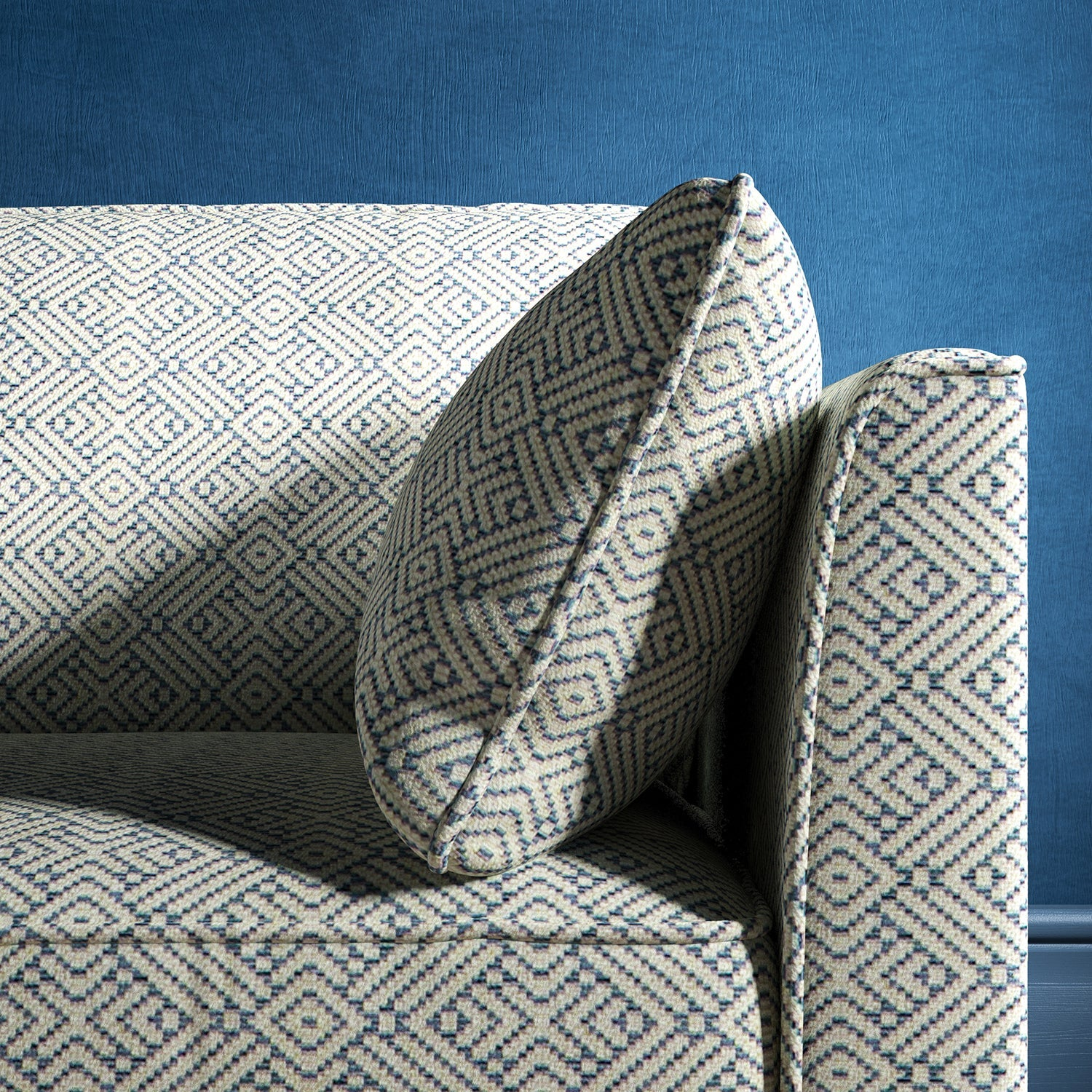 Sofa upholstered in a sky blue and neutral geometric weave upholstery fabric