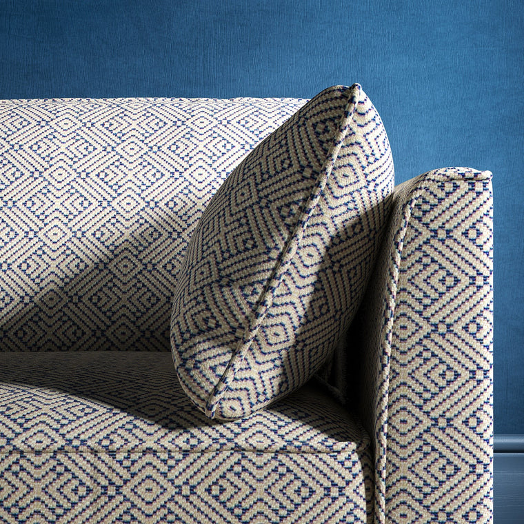 Sofa upholstered in a indigo blue and neutral geometric weave upholstery fabric