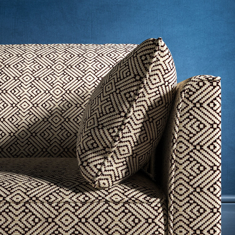 Sofa upholstered in a monochrome geometric weave upholstery fabric