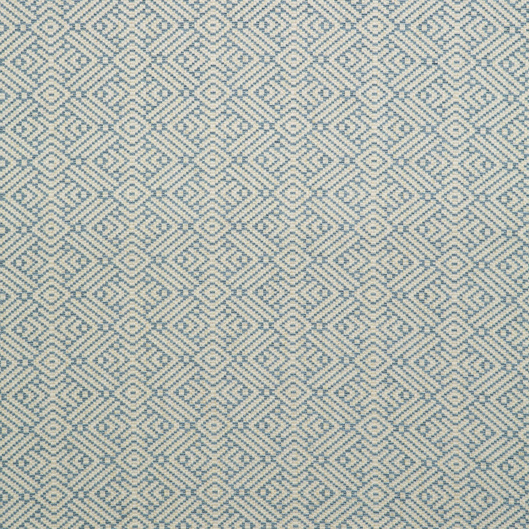 Fabric swatch of a blue and neutral geometric weave fabric for curtains and upholstery