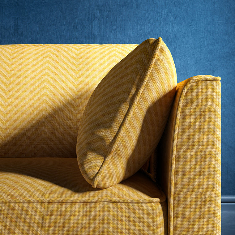 Sofa upholstered in a yellow herringbone weave upholstery fabric