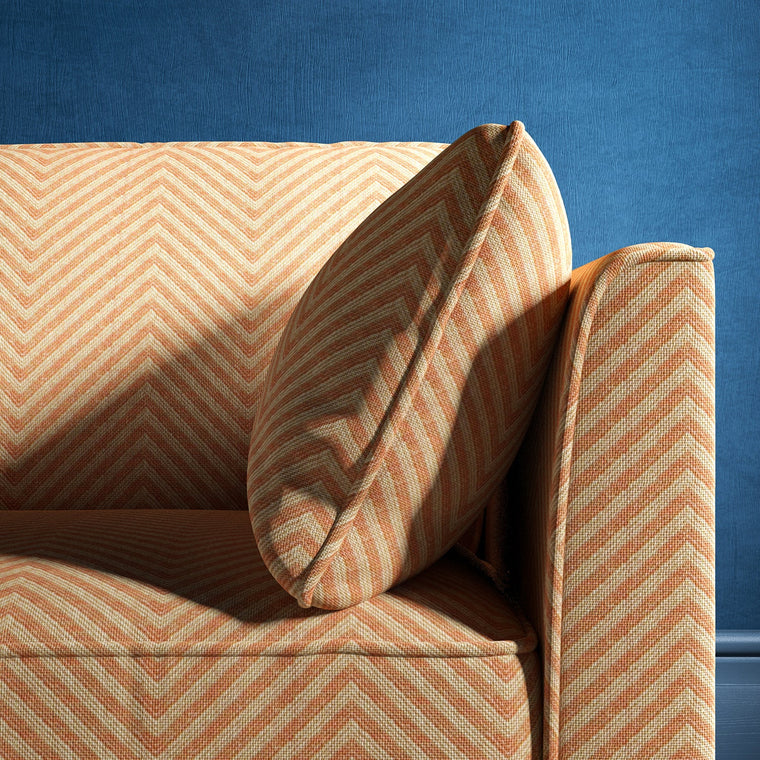 Sofa upholstered in a orange herringbone weave upholstery fabric