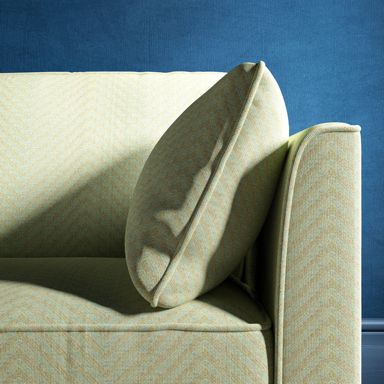 Sofa upholstered in a duck egg blue herringbone weave upholstery fabric