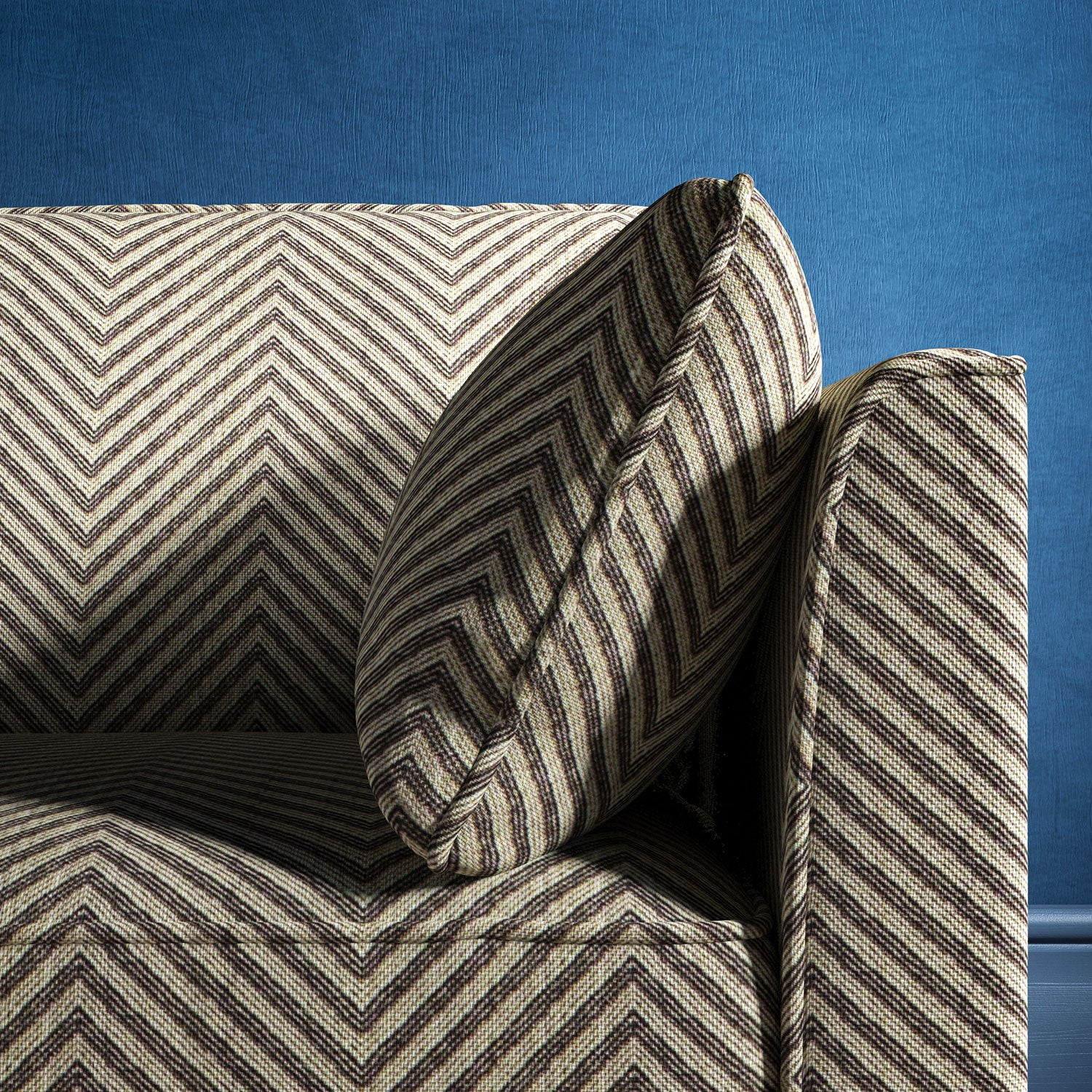 Sofa upholstered in a dark grey herringbone weave upholstery fabric