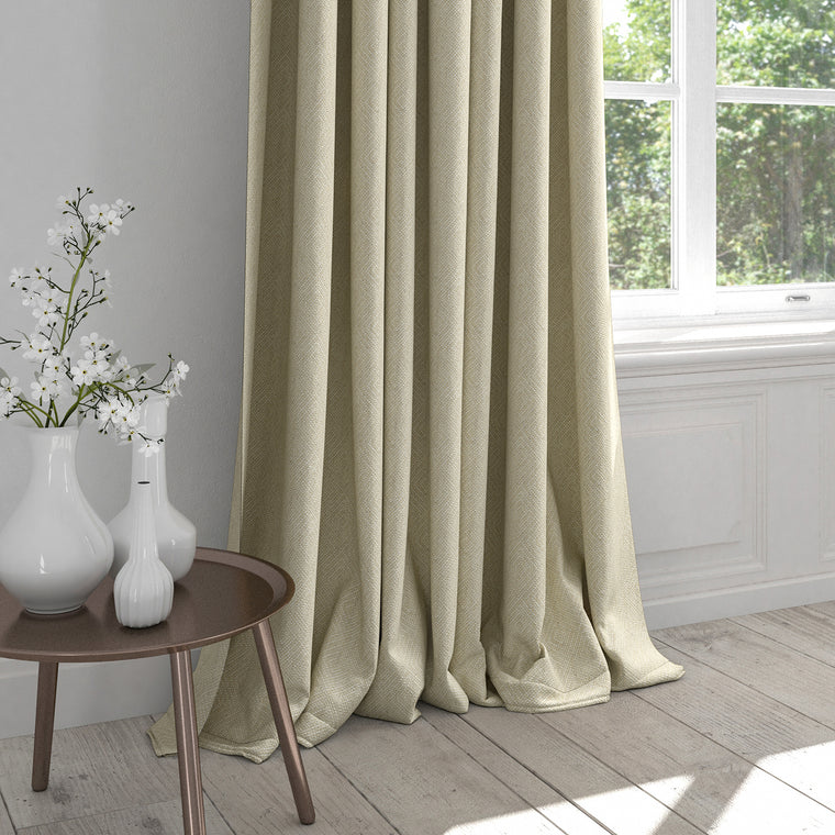 Curtain in a cream fabric with a white woven geometric design