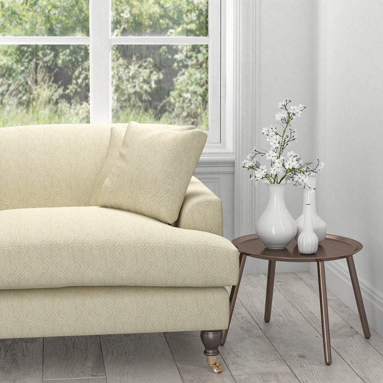 Sofa in a cream fabric with a white woven geometric design