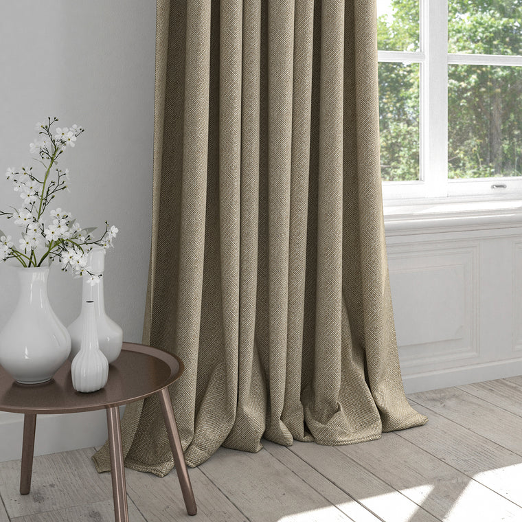 Curtain in a neutral fabric with a light geometric woven design