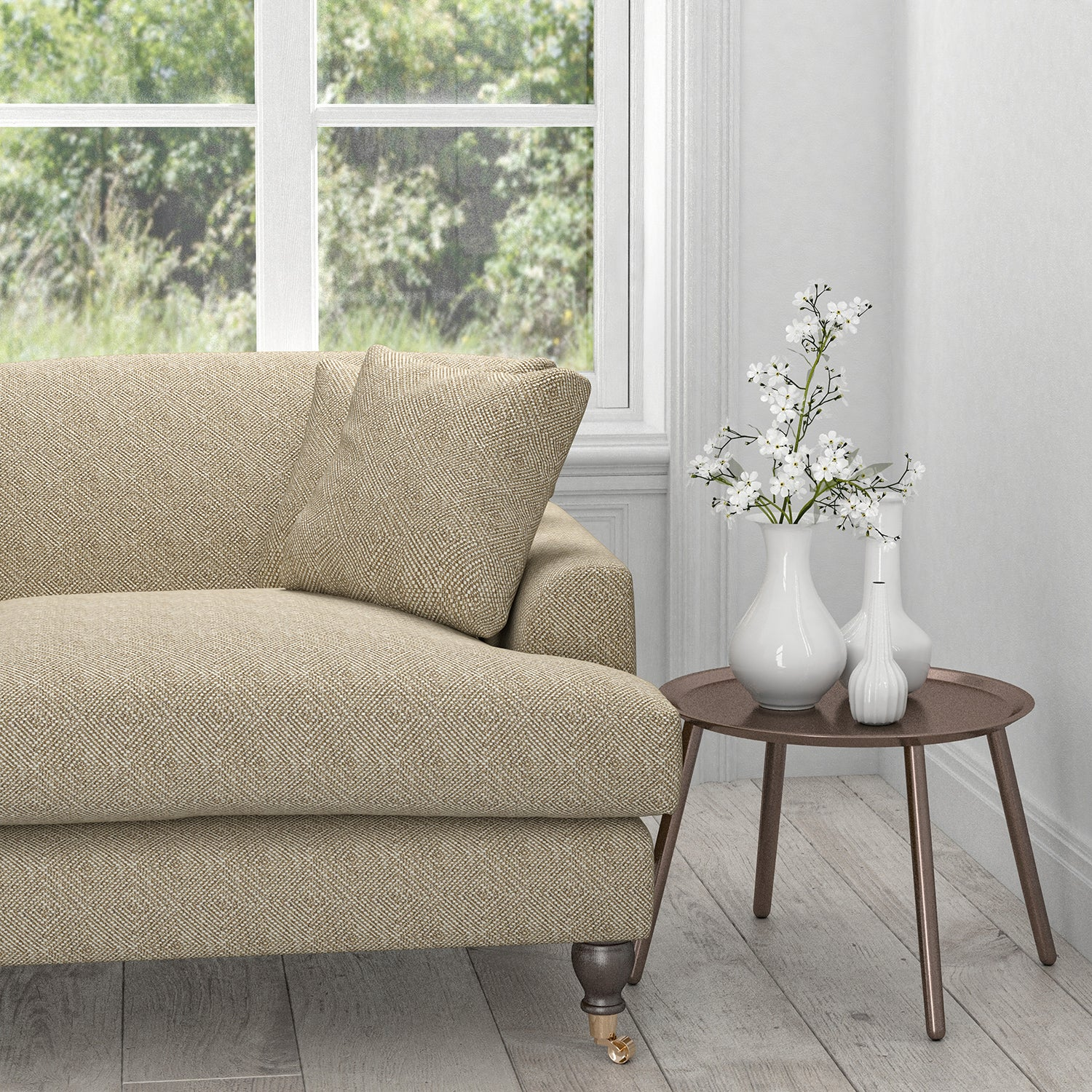 Sofa in a neutral fabric with a white geometric woven design