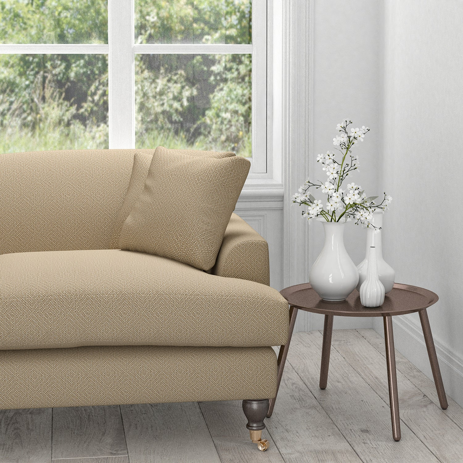 Sofa in a neutral fabric with a light neutral geometric woven design