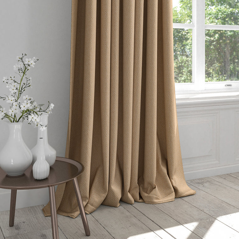 Curtain in a beige neutral curtain with a light neutral woven geometric design
