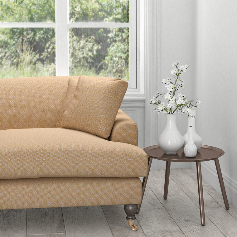Sofa in a beige neutral fabric with a light neutral woven geometric design