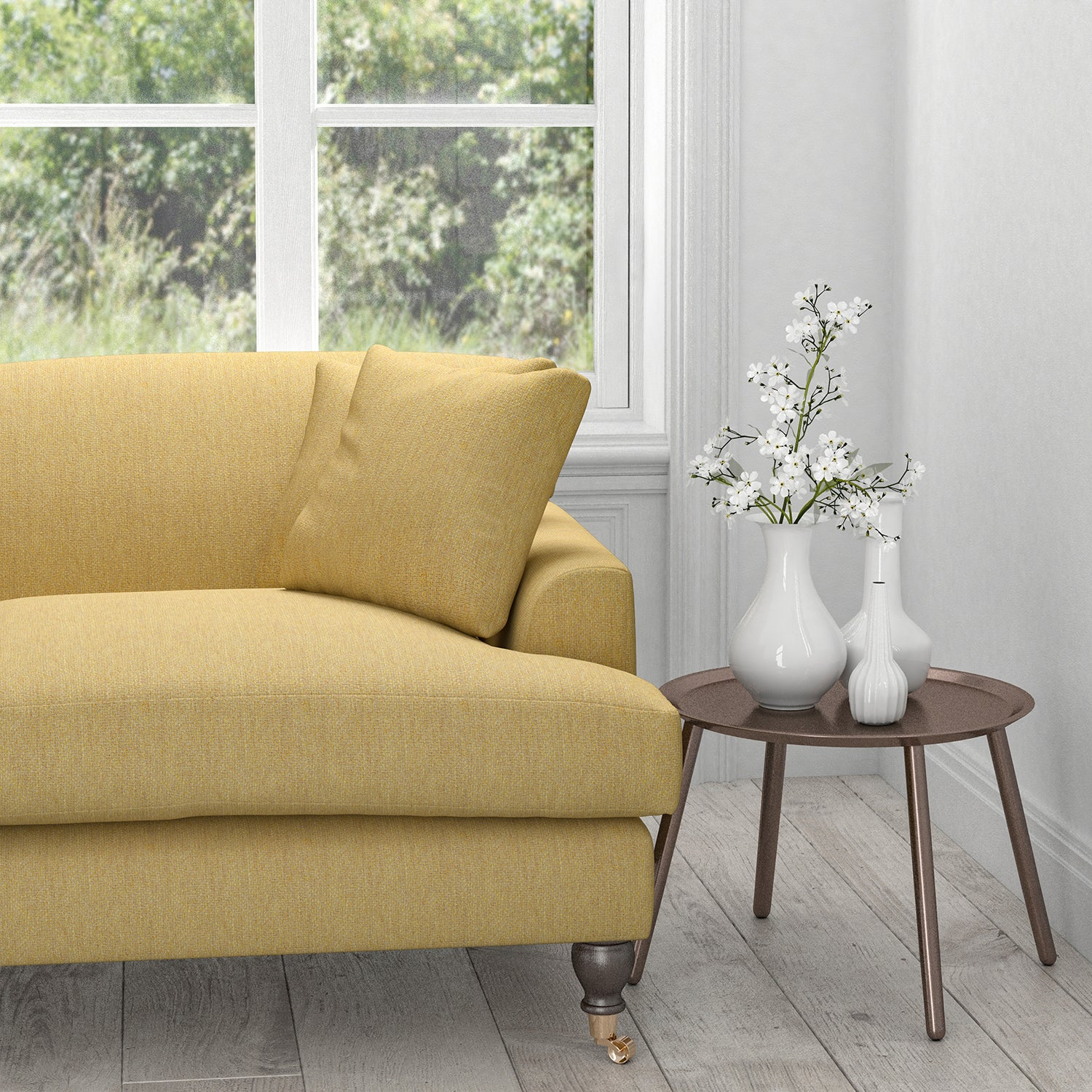 Sofa in a light yellow fabric with neutral woven geometric design