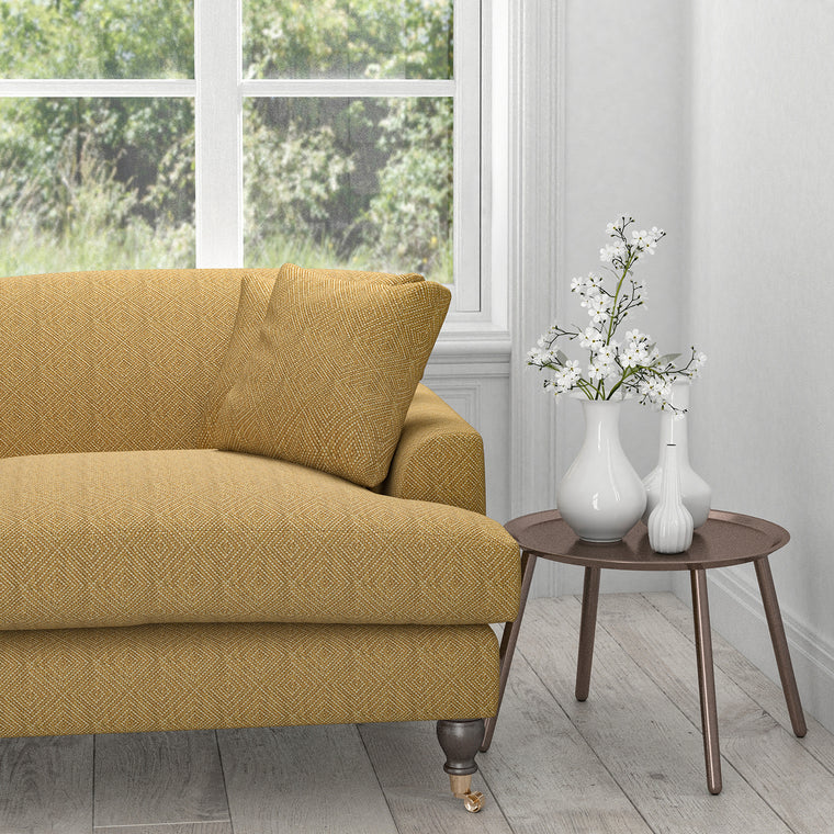Sofa in a mustard yellow fabric with a light woven geometric design