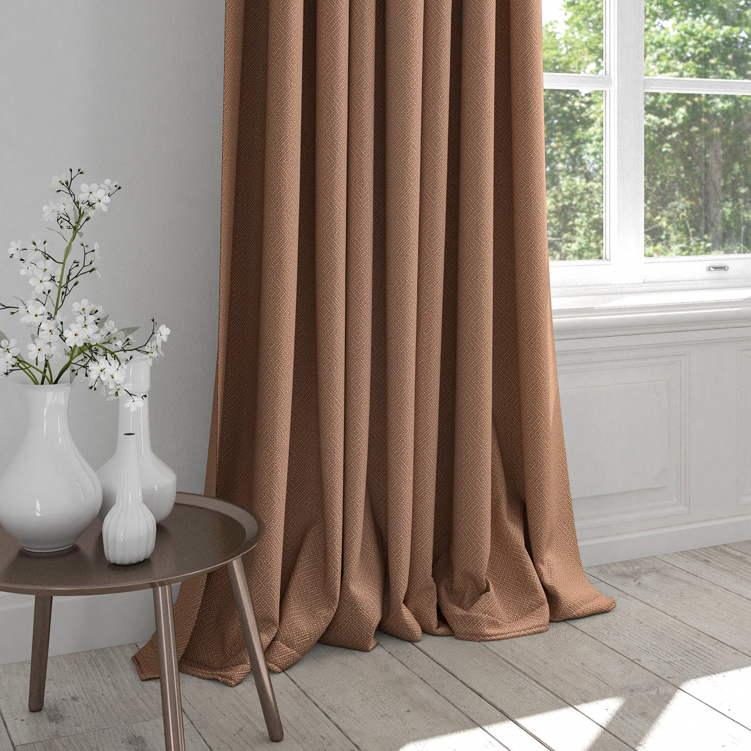 Curtain in an orange fabric with light neutral woven geometric design