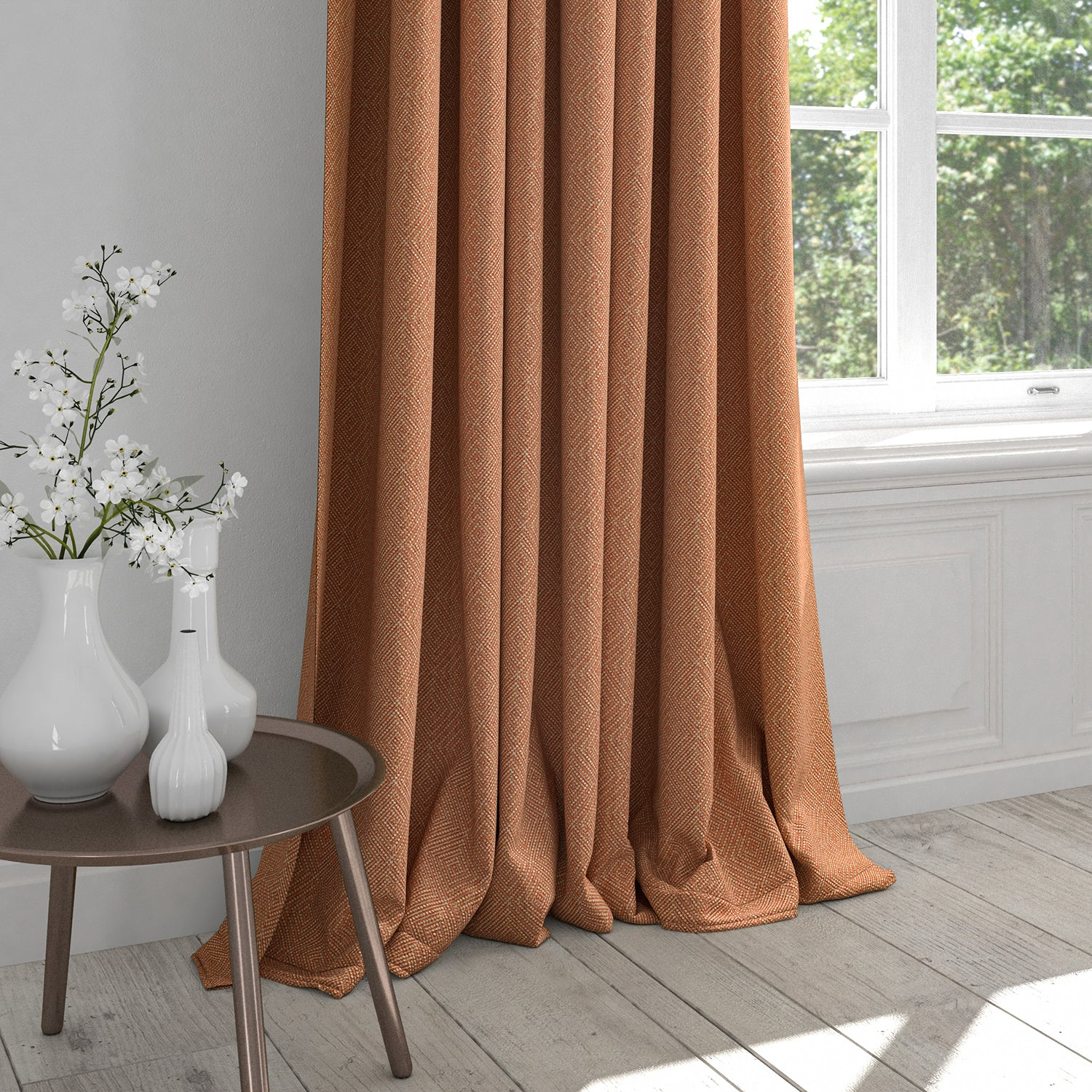 Curtain in an orange fabric with a light woven geometric design