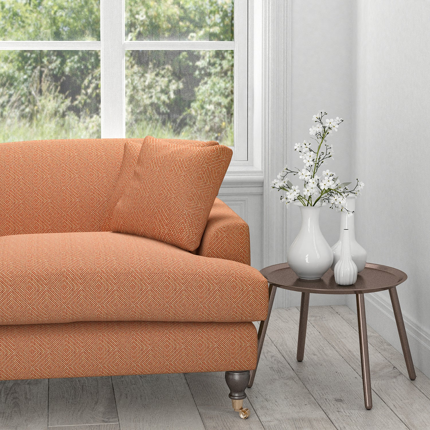Sofa in an orange fabric with a neutral woven geometric design