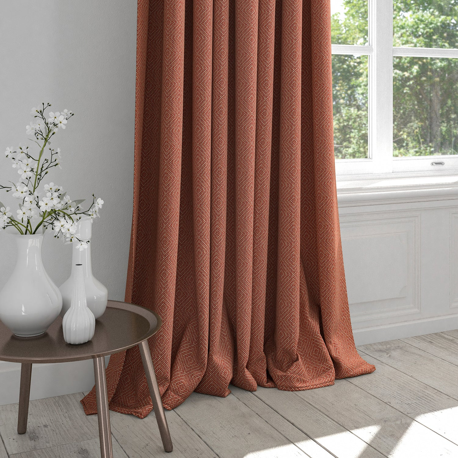 Curtain in a terracotta fabric with light neutral woven geometric design