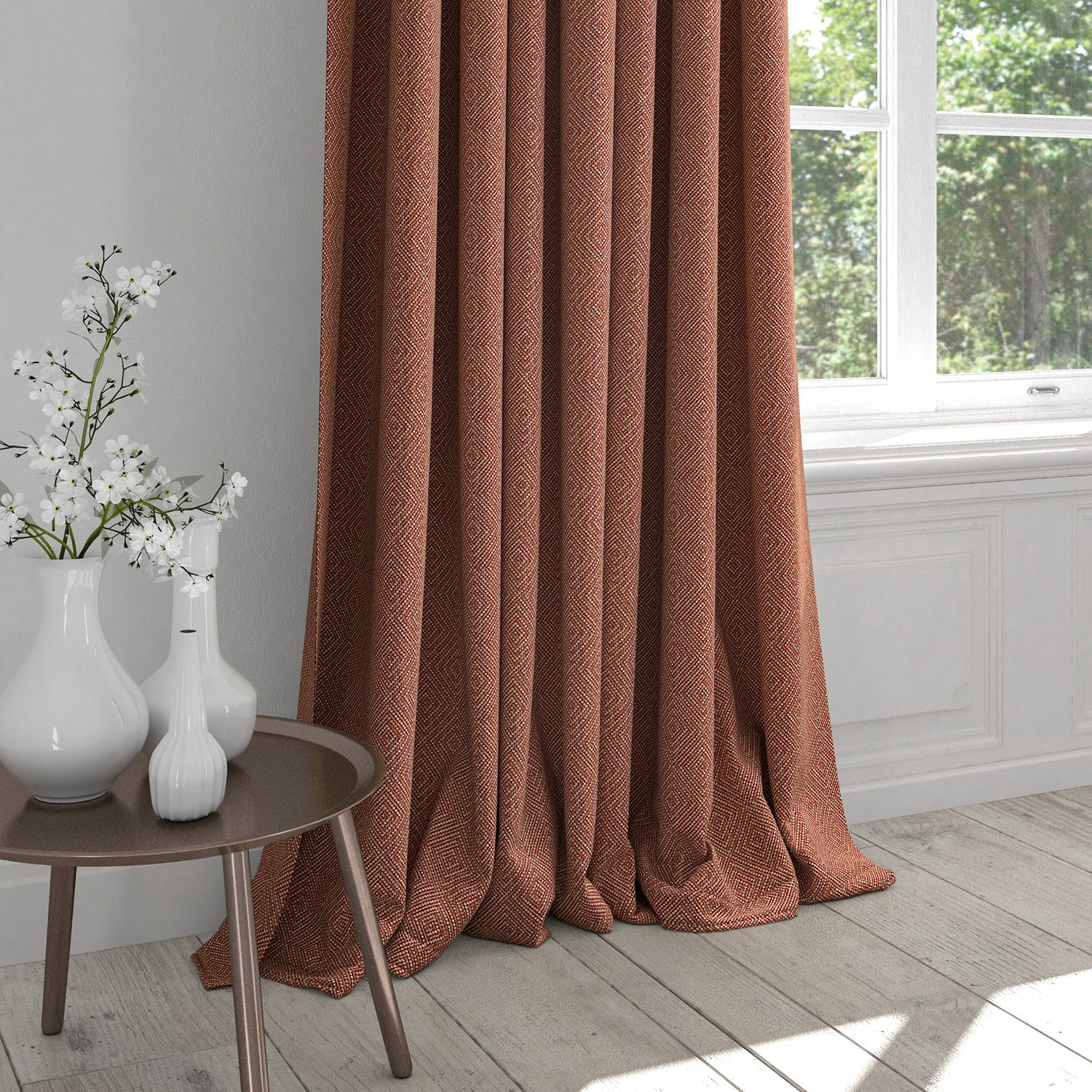 Curtain in a raspberry red fabric with a light neutral woven geometric design