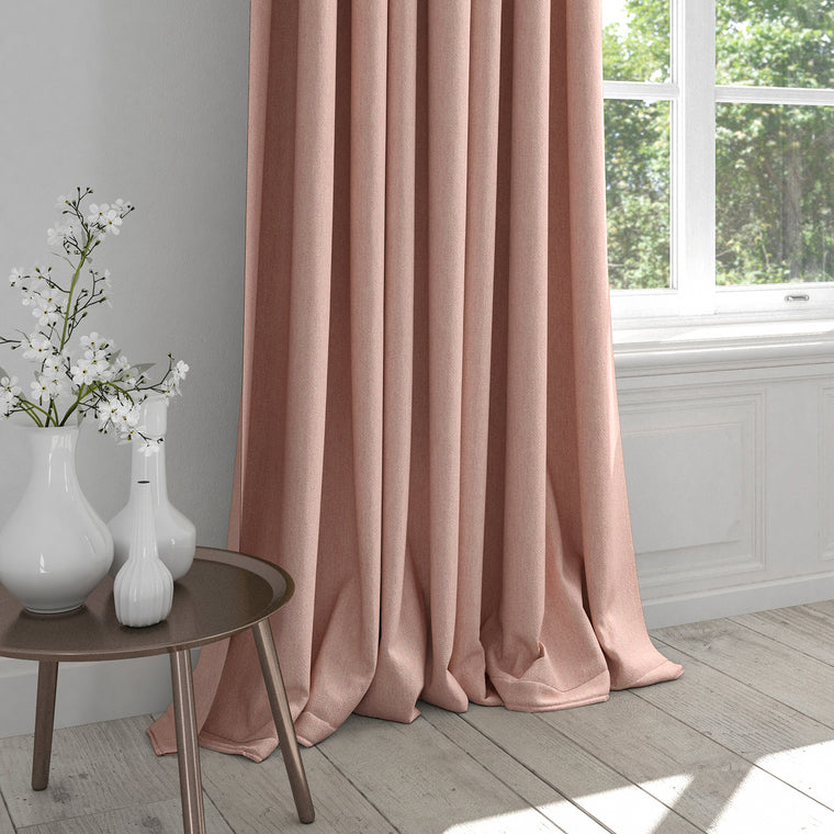 Curtain in a light pink fabric with light geometric woven design