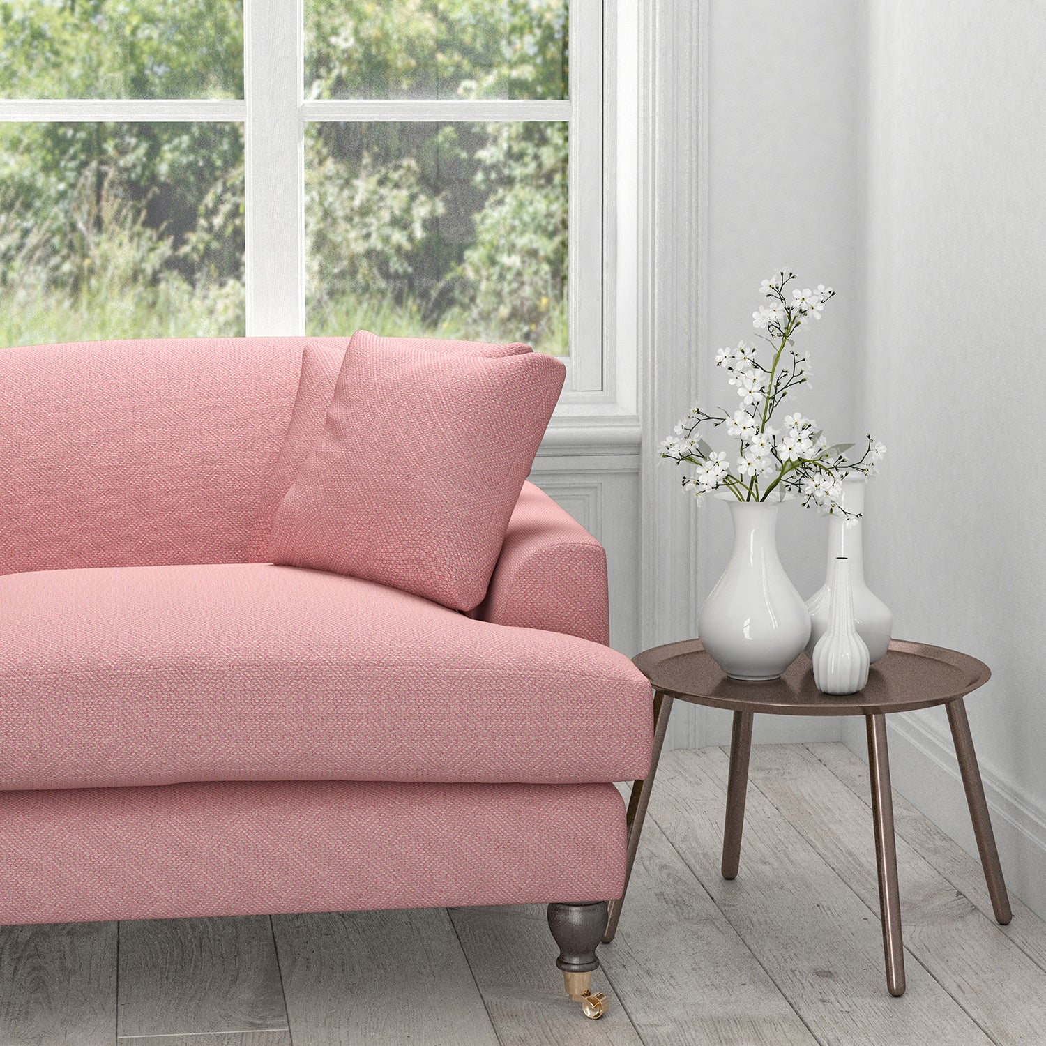 Sofa in a pink fabric with a light geometric woven design