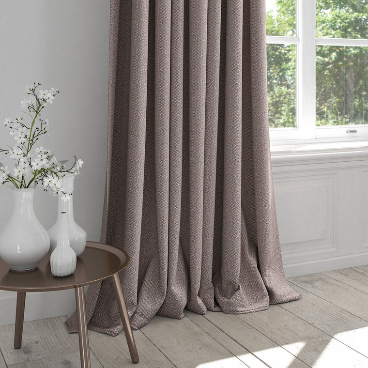 Curtain in a purple fabric with a light woven geometric design