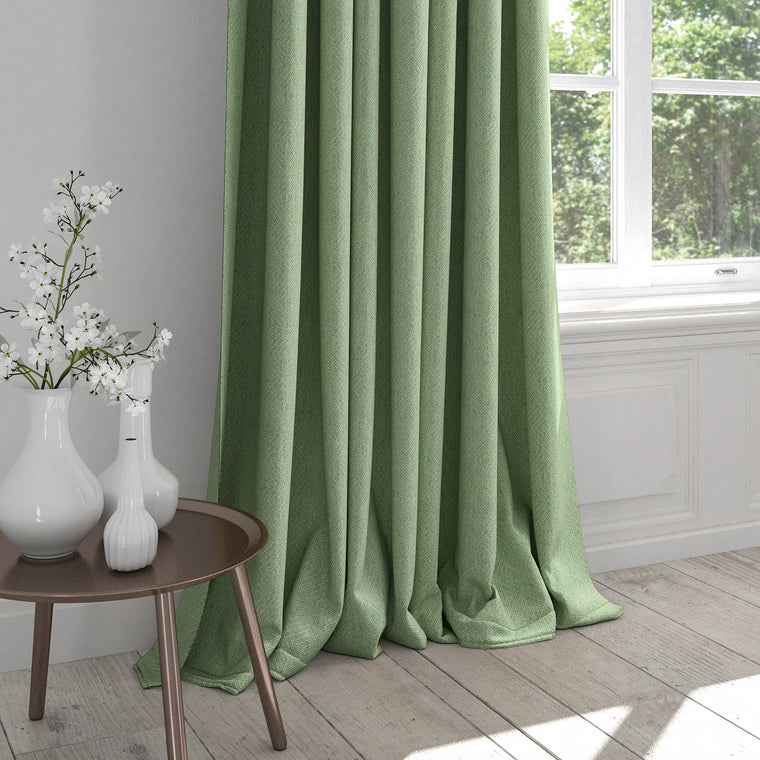 Curtains in a light green fabric with a light woven geometric design
