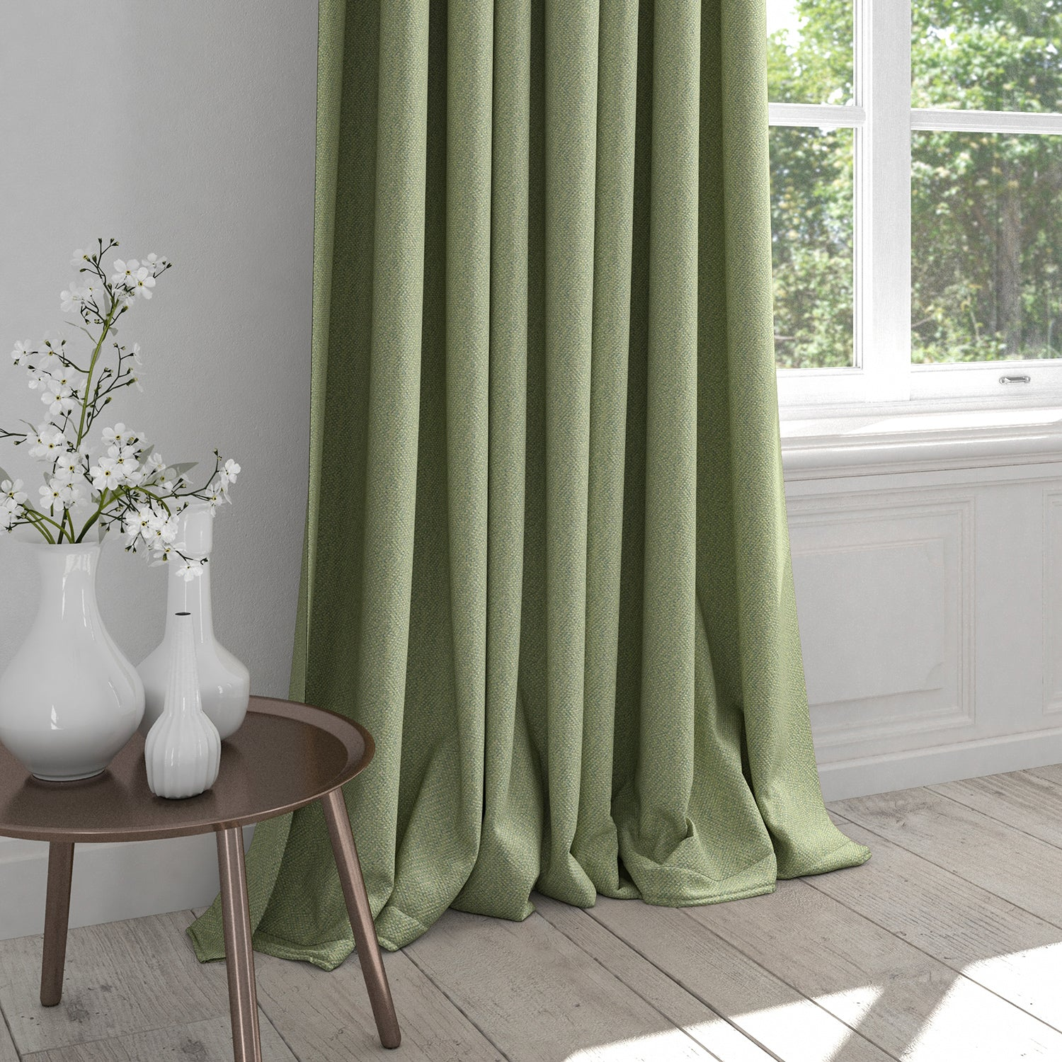 Curtain in a light green fabric with neutral woven geometric design