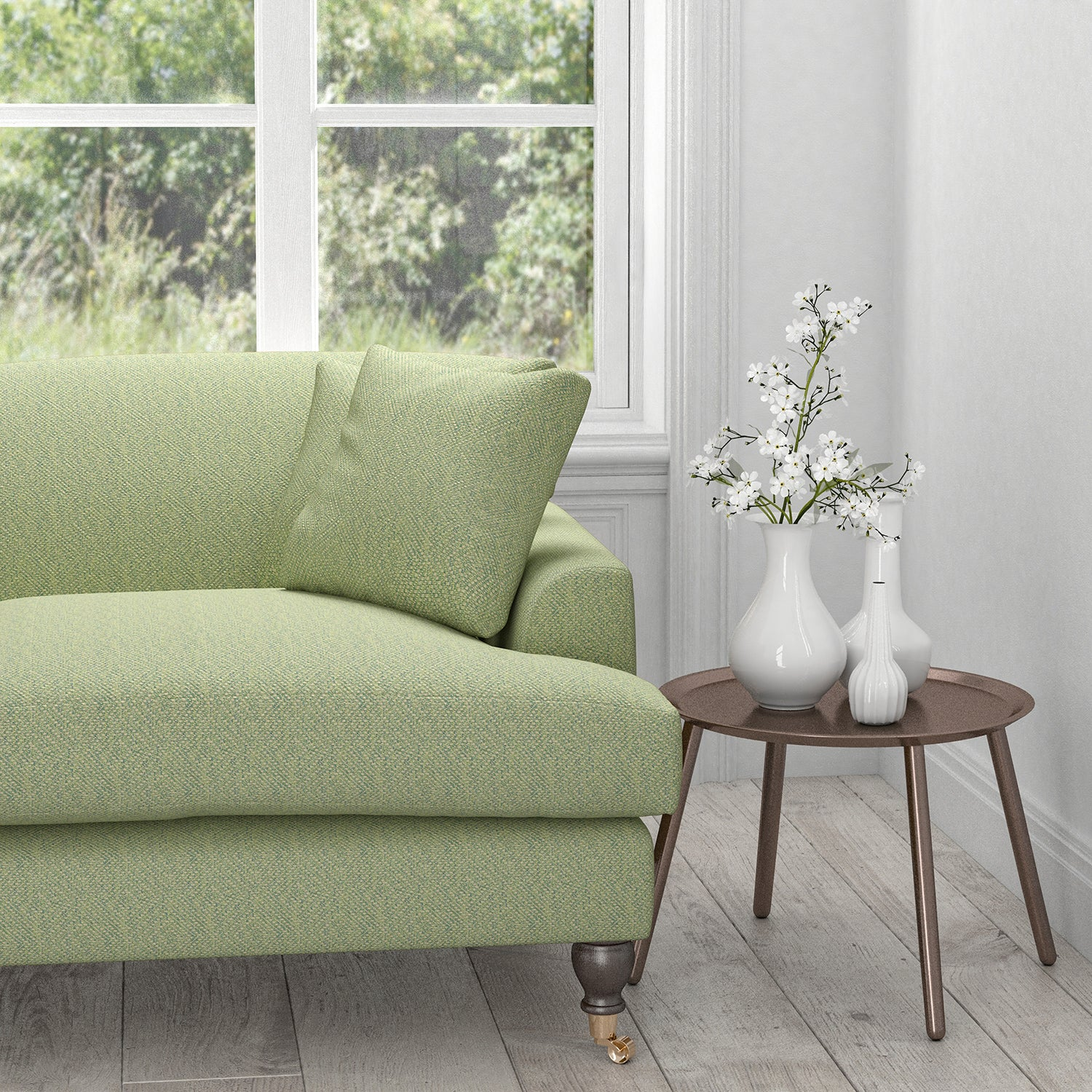 Sofa in a light green upholstery fabric with a neutral woven geometric design