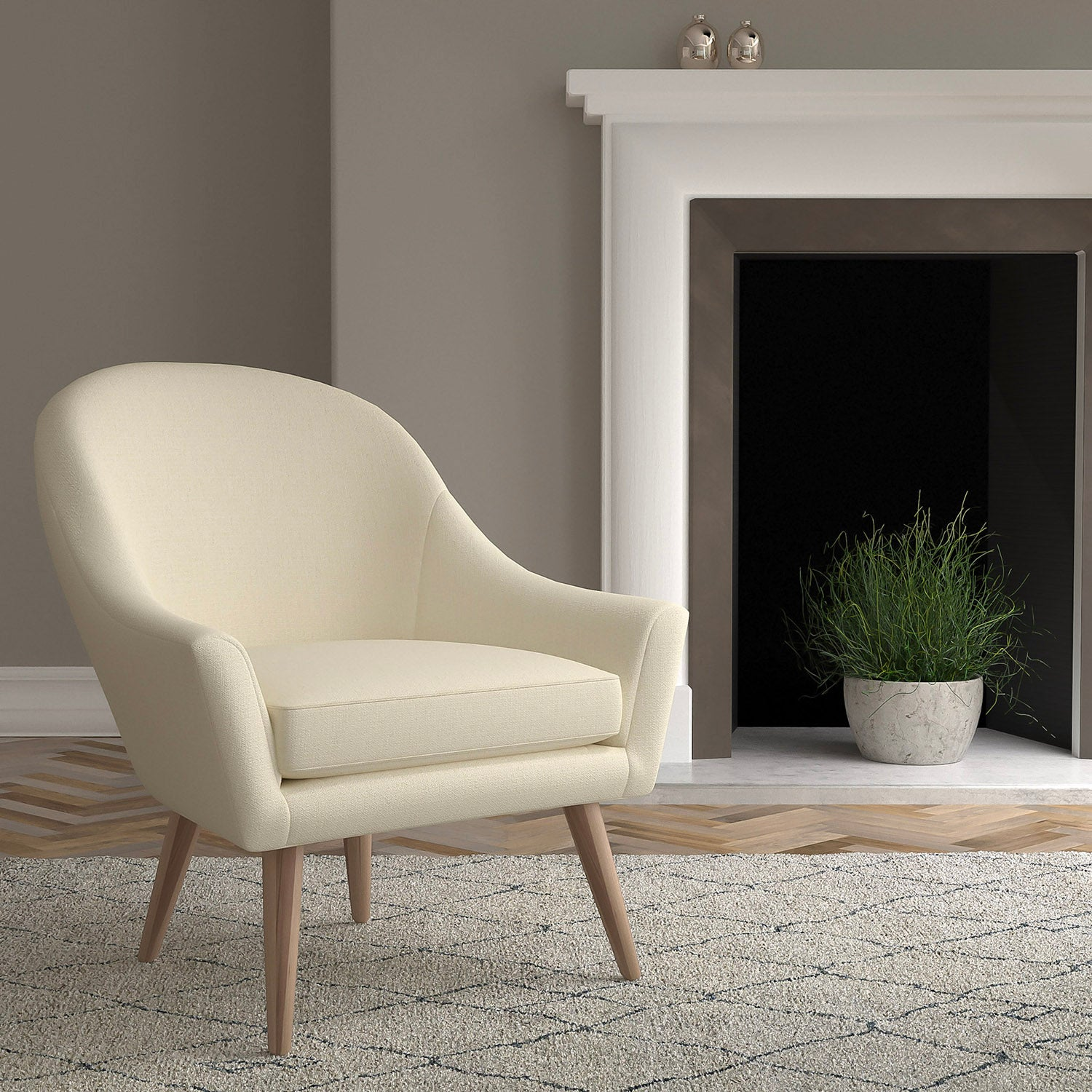 Chair in a light neutral upholstery fabric with a small diamond design and a stain resistant finish