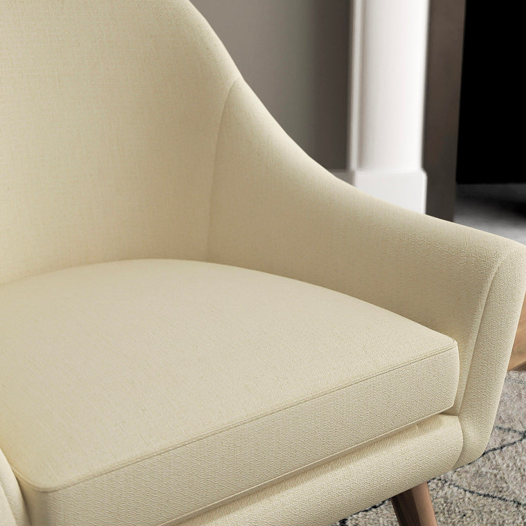 Chair with a light neutral upholstery fabric with a small diamond weave fabric