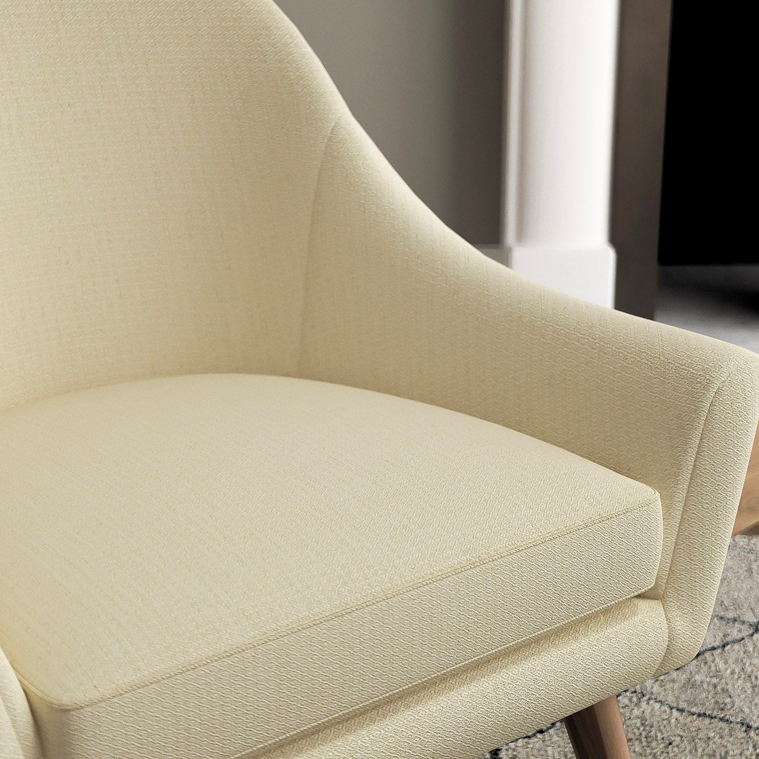Chair with a neutral upholstery fabric with a small diamond weave fabric