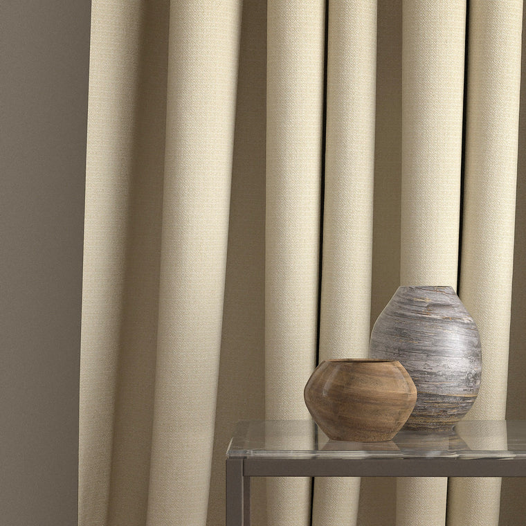 Curtain in a neutral weave fabric with a small diamond design and a stain resistant finish