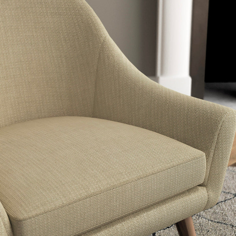 Chair with a beige and neutral upholstery fabric with a small diamond weave fabric