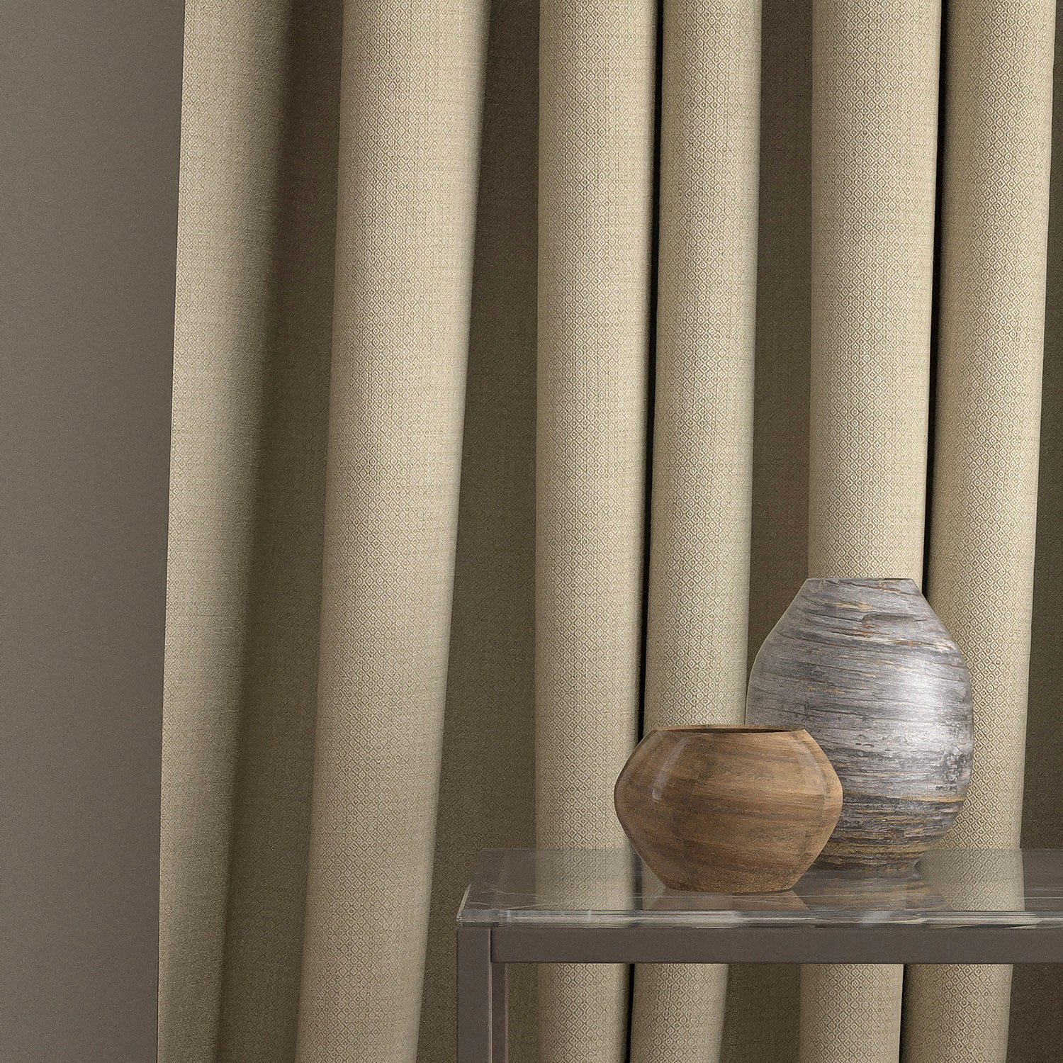 Curtain in a beige and neutral weave fabric with a small diamond design and a stain resistant finish