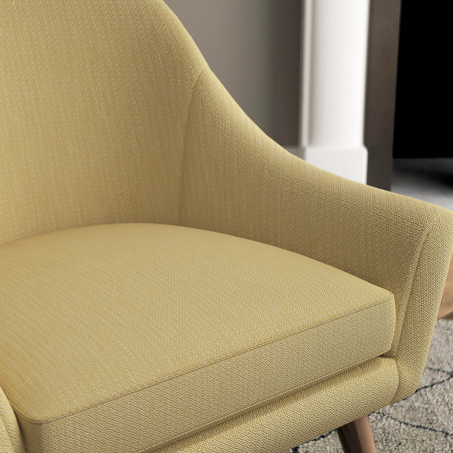 Chair with a bright yellow and neutral upholstery fabric with a small diamond weave fabric