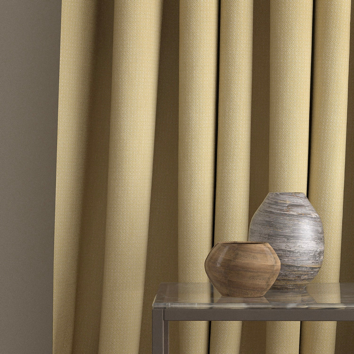 Curtain in a bright yellow and neutral weave fabric with a small diamond design and a stain resistant finish