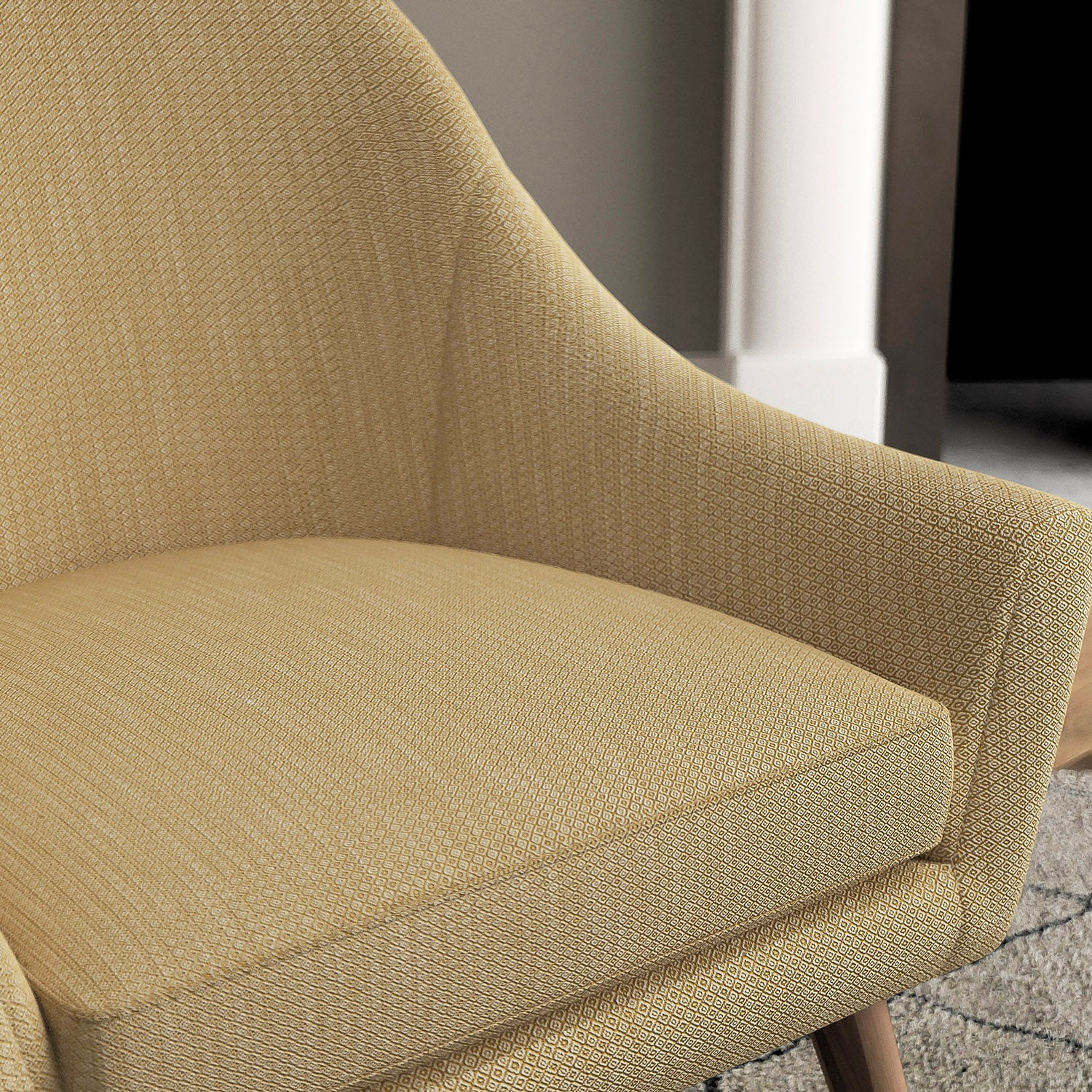 Chair with a yellow and neutral upholstery fabric with a small diamond weave fabric