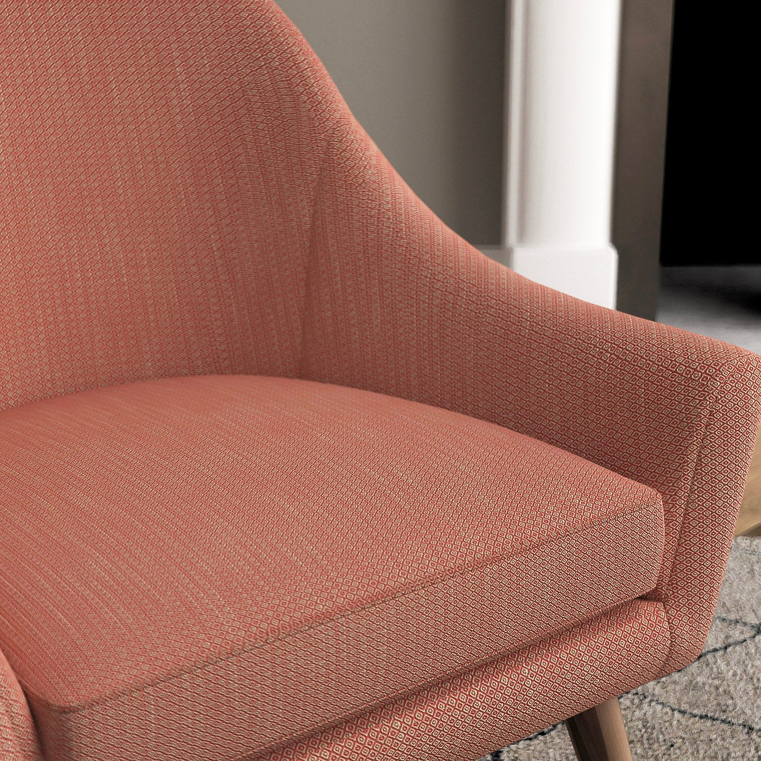Chair with a berry and neutral upholstery fabric with a small diamond weave fabric