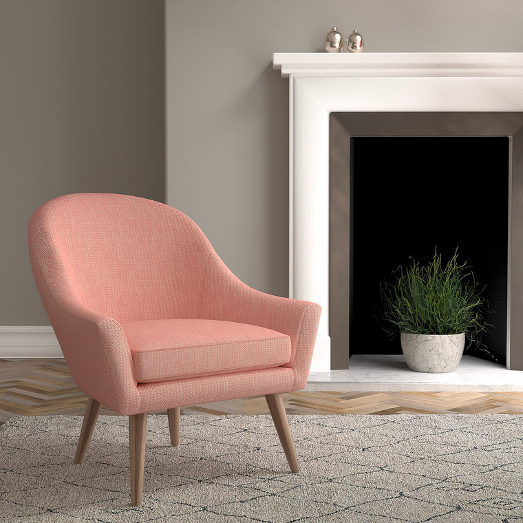 Chair in a bright pink and neutral upholstery fabric with a small diamond design and a stain resistant finish