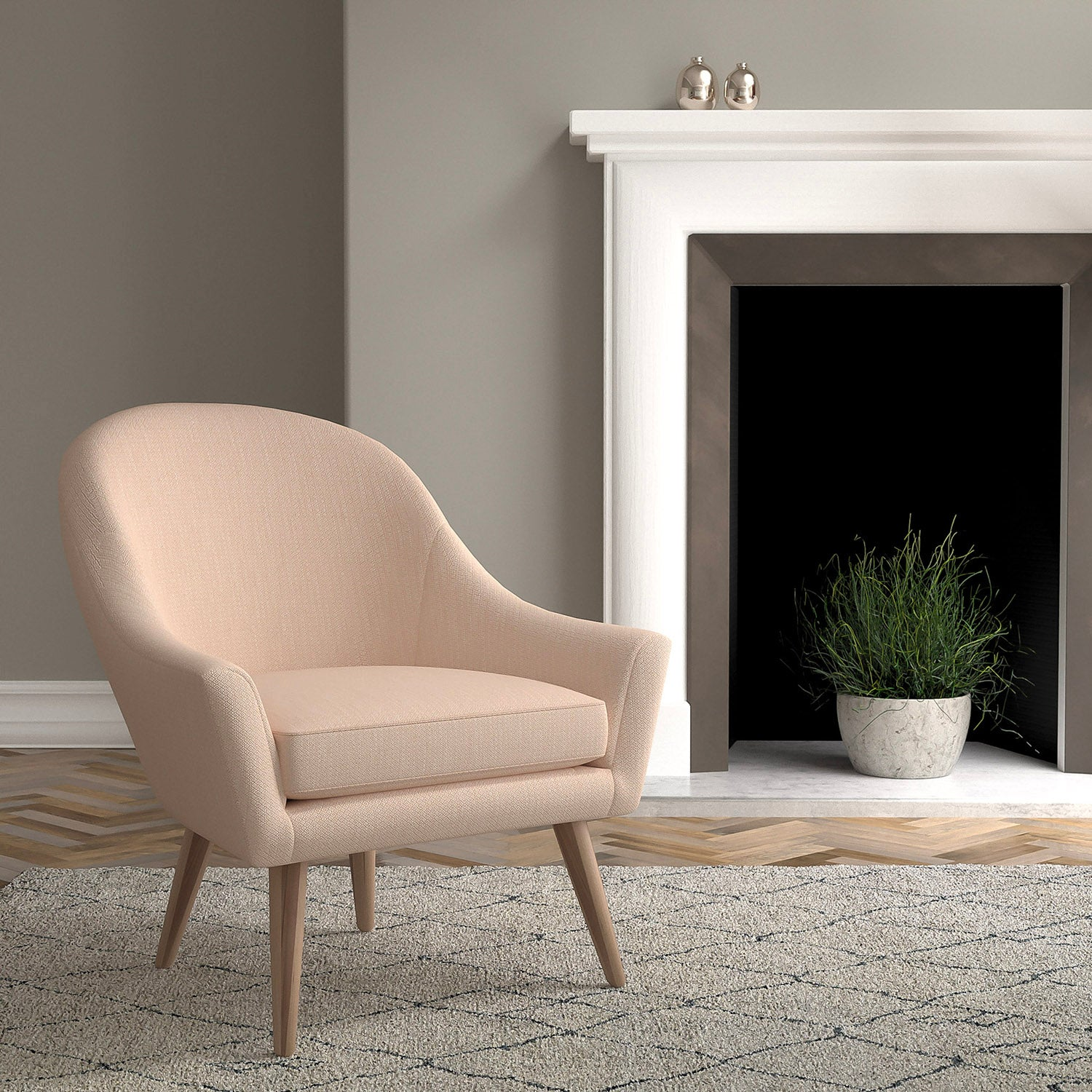 Chair in a blush pink and neutral upholstery fabric with a small diamond design and a stain resistant finish