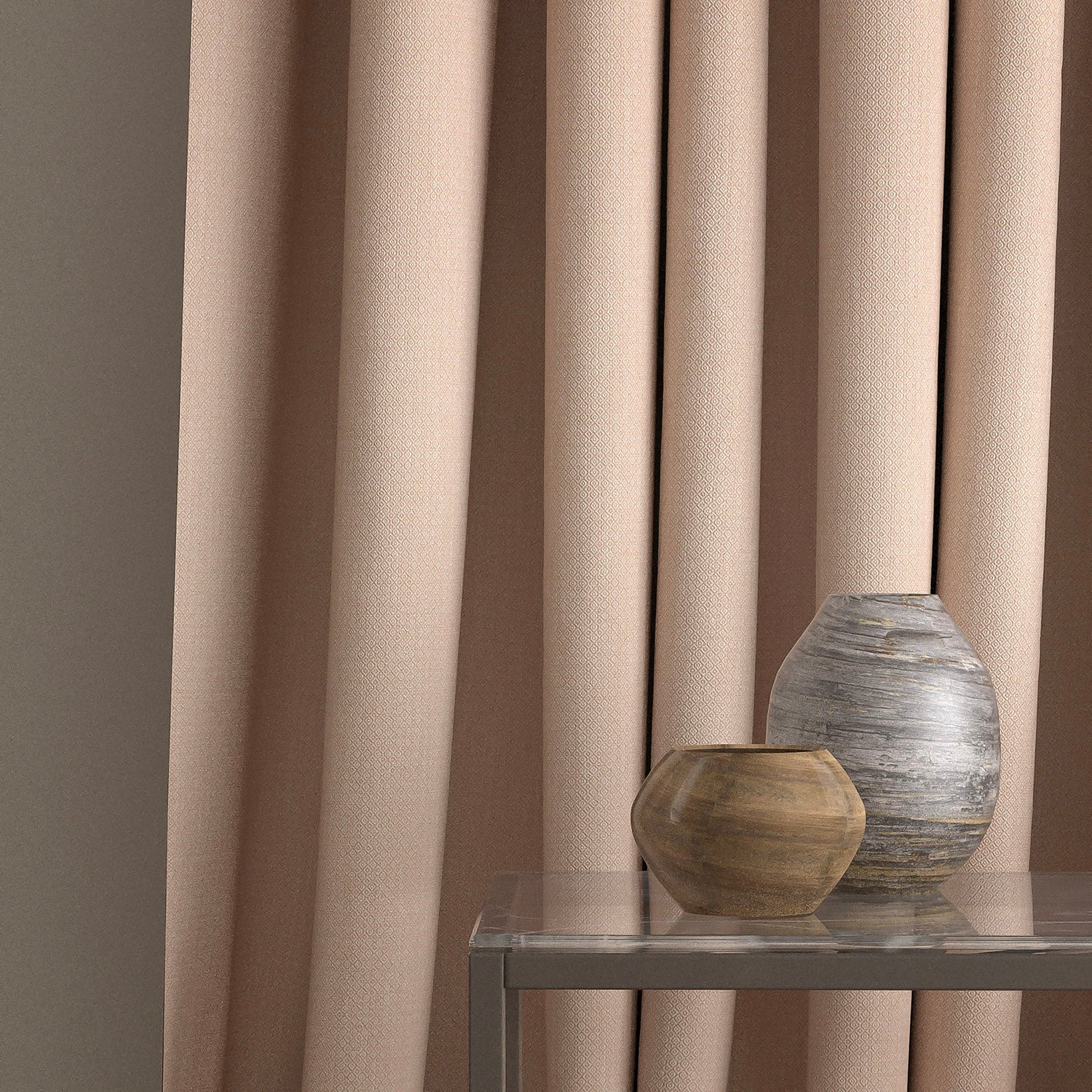 Curtain in a blush pink and neutral weave fabric with a small diamond design and a stain resistant finish
