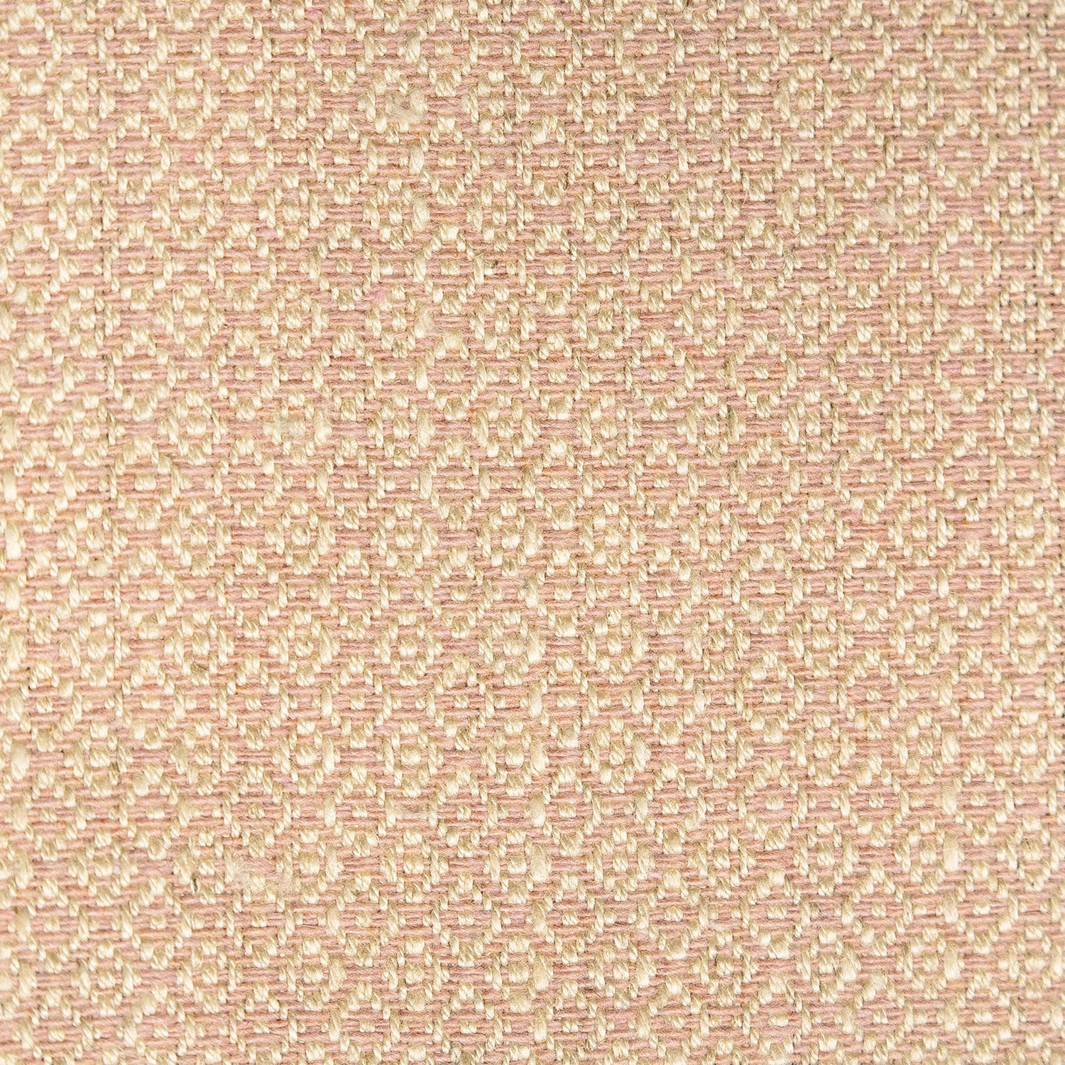 Fabric sample of a blush pink and neutral weave fabric with a small diamond design and stain resistant finish for curtains and upholstery