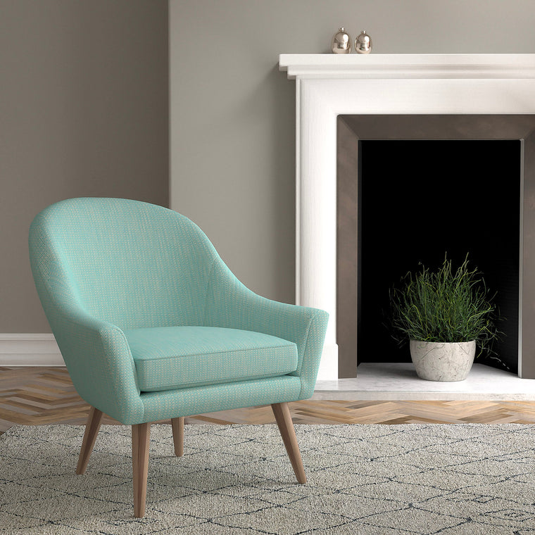 Chair in a turquoise and neutral upholstery fabric with a small diamond design and a stain resistant finish