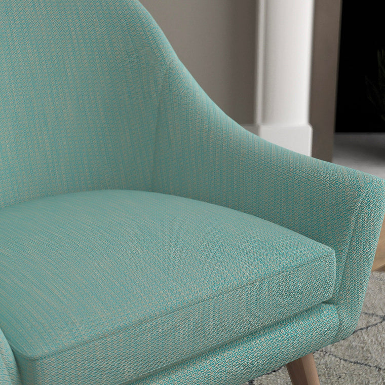 Chair with a turquoise and neutral upholstery fabric with a small diamond weave fabric