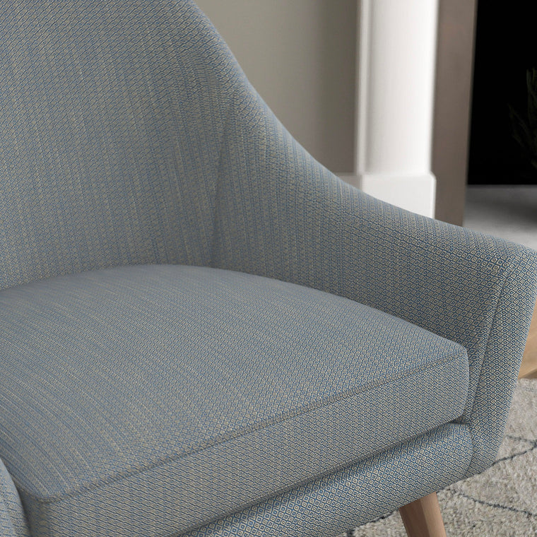 Chair with a bright blue and neutral upholstery fabric with a small diamond weave fabric