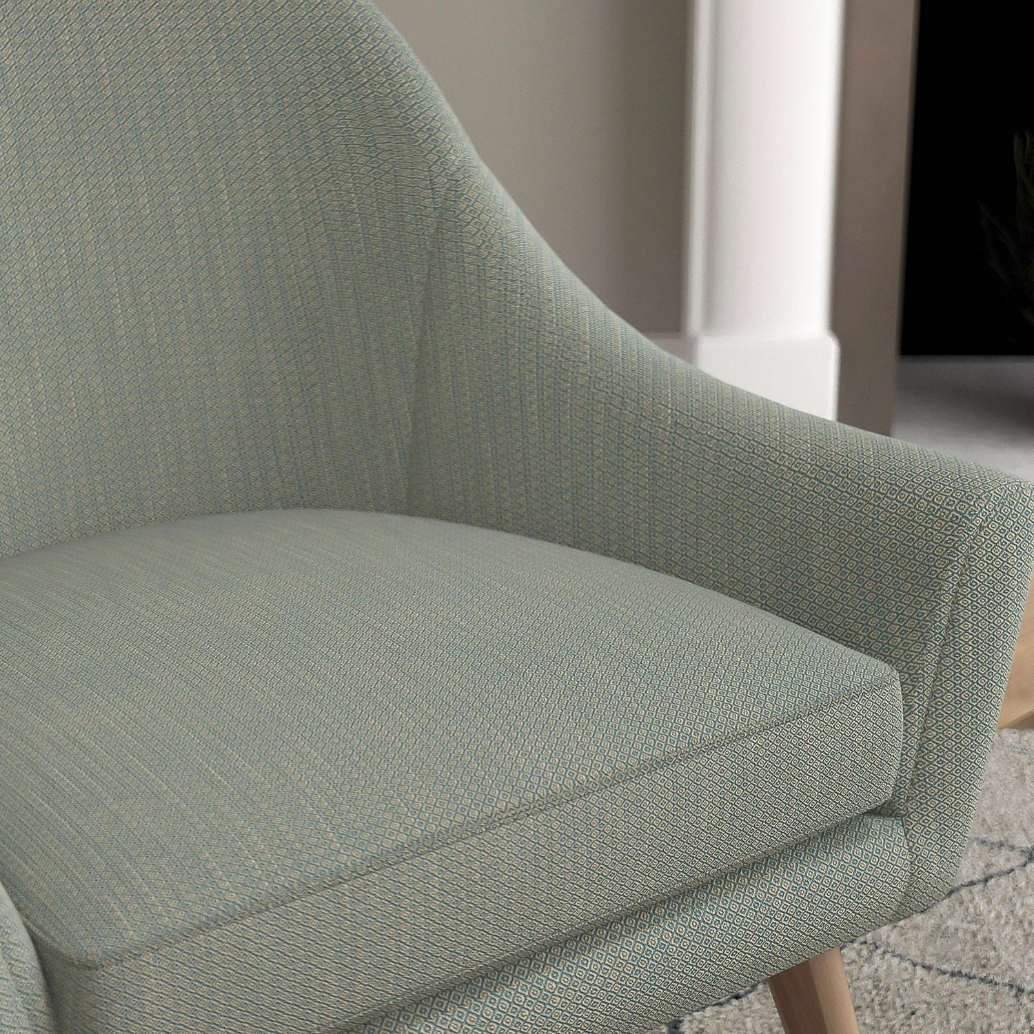 Chair with a blue and neutral upholstery fabric with a small diamond weave fabric