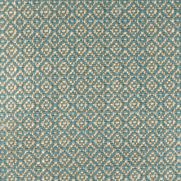 Fabric sample of a blue and neutral weave fabric with a small diamond design and stain resistant finish for curtains and upholstery