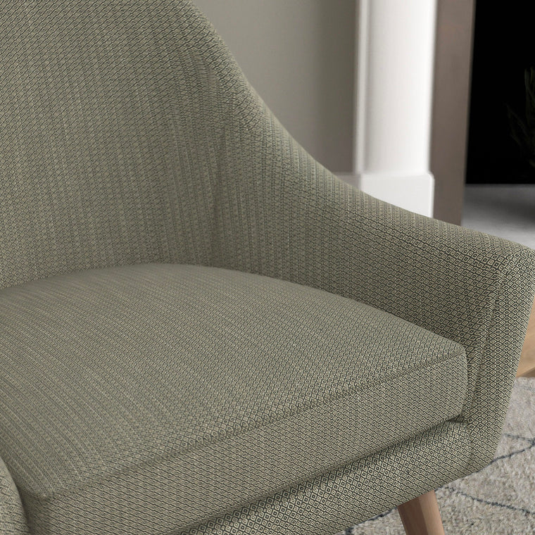 Chair with a dark grey and neutral upholstery fabric with a small diamond weave fabric