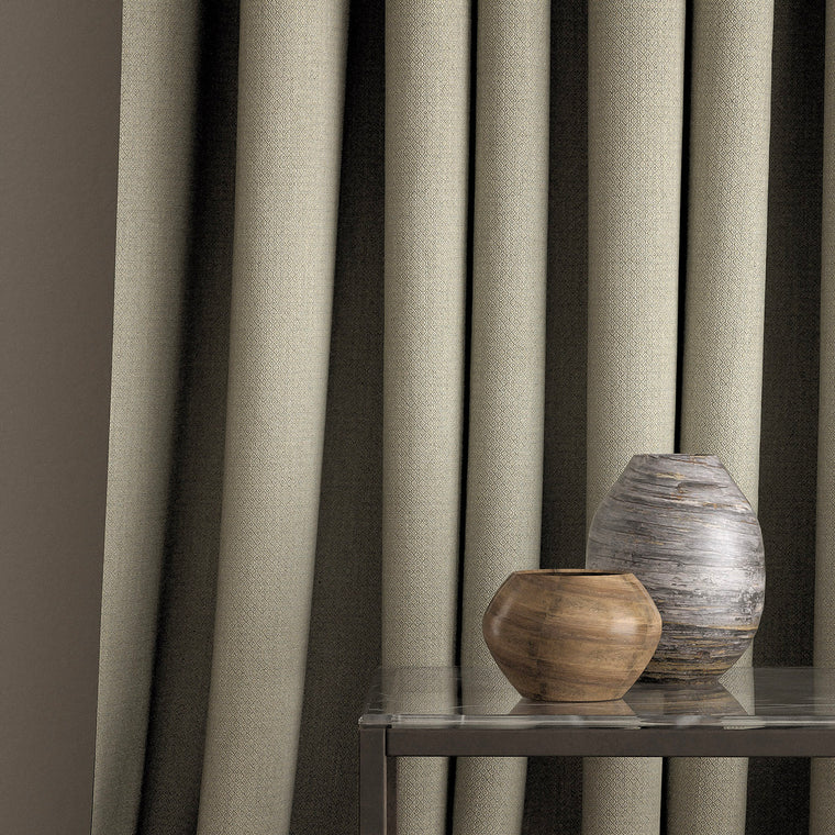 Curtain in a grey-blue and neutral weave fabric with a small diamond design and a stain resistant finish