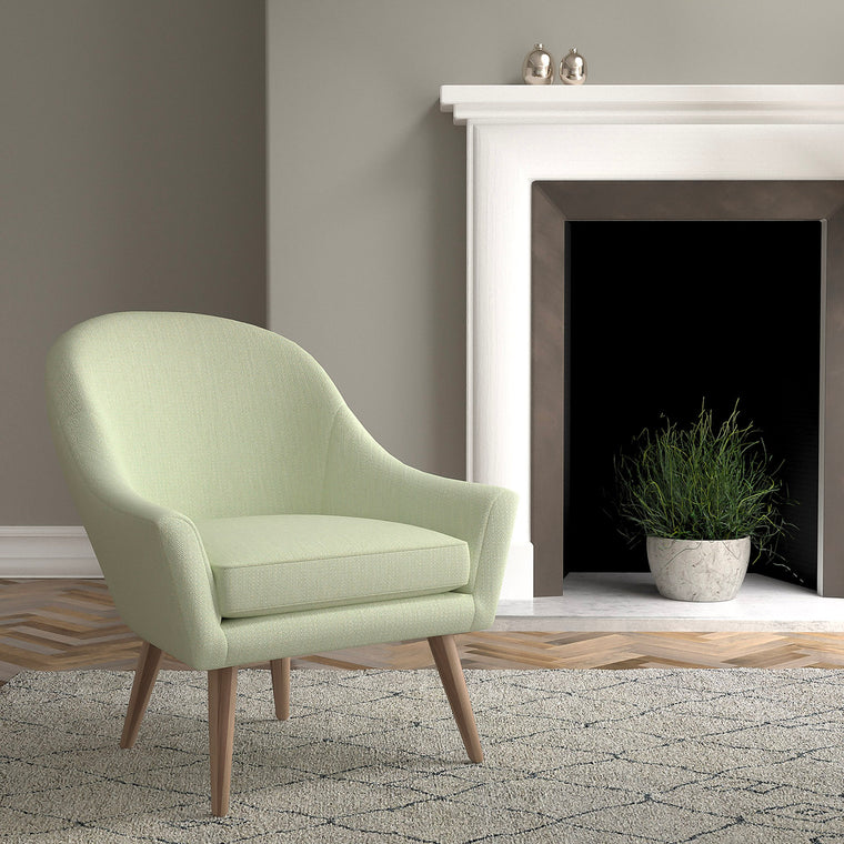 Chair in a mint green and neutral upholstery fabric with a small diamond design and a stain resistant finish